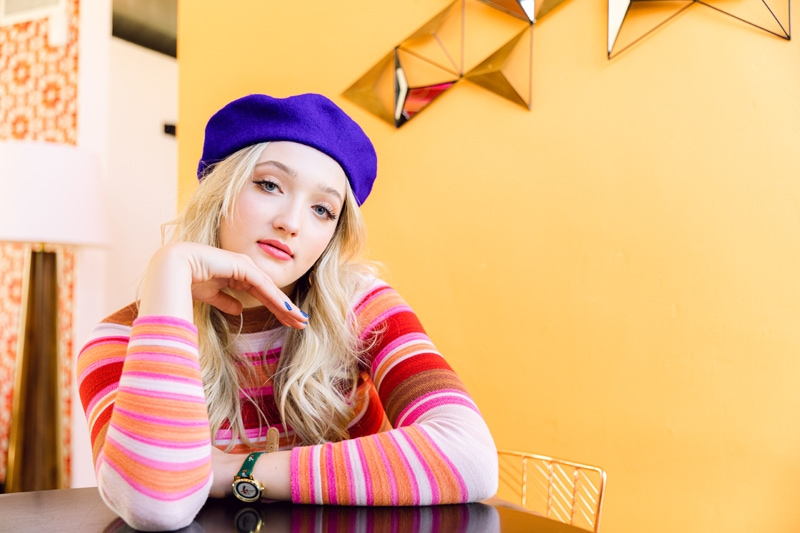 San Diego Senior Photographer, girl leaning on table with purple hat